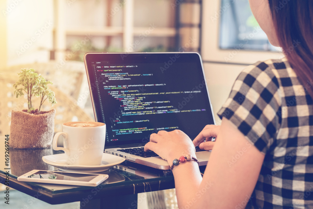 Fototapeta Programmer Typing New Lines of HTML Code. Laptop and Hand Closeup. Working Time. Web Design Business and Web Development Concept. Relaxing Environment. Freelance Work. Programming for all Genders.