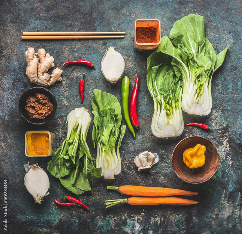 Flat lay with asian cooking ingredients pak choi ginger spices flat lay with asian cooking ingredients pak choi ginger spices chili and forumfinder Images