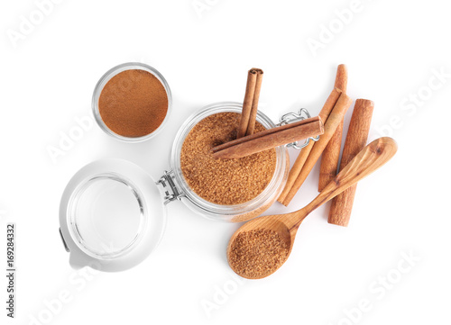 Composition with sweet cinnamon sugar on white background