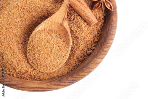 Photo Stands Herbs 2 Wooden bowl and spoon with sweet cinnamon sugar on white background