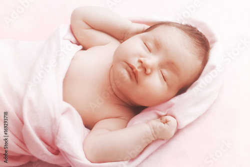 Newborn baby girl sleep on pink blanket Wallpaper Mural