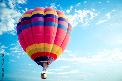 Aluminium Prints Balloon Colorful hot air balloon flying on sky. travel and air transportation concept - balloon carnival in Thailand