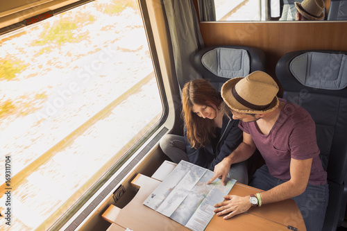 Travelers planning a travel on a train