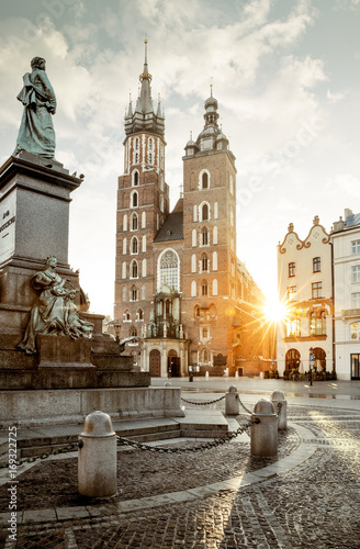 Fotobehang Krakau Adam Mickiewicz monument and St. Mary's Basilica on Main Square in Krakow, Poland