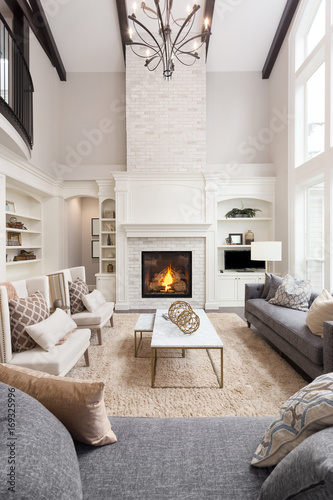 Beautiful Living Room Interior With Hardwood Floors And Fireplace In New  Luxury Home, Vertical Orientation