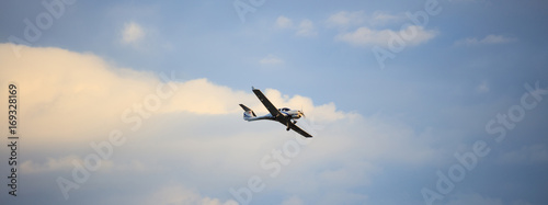 Stampa su Tela Small plane on blue sky background