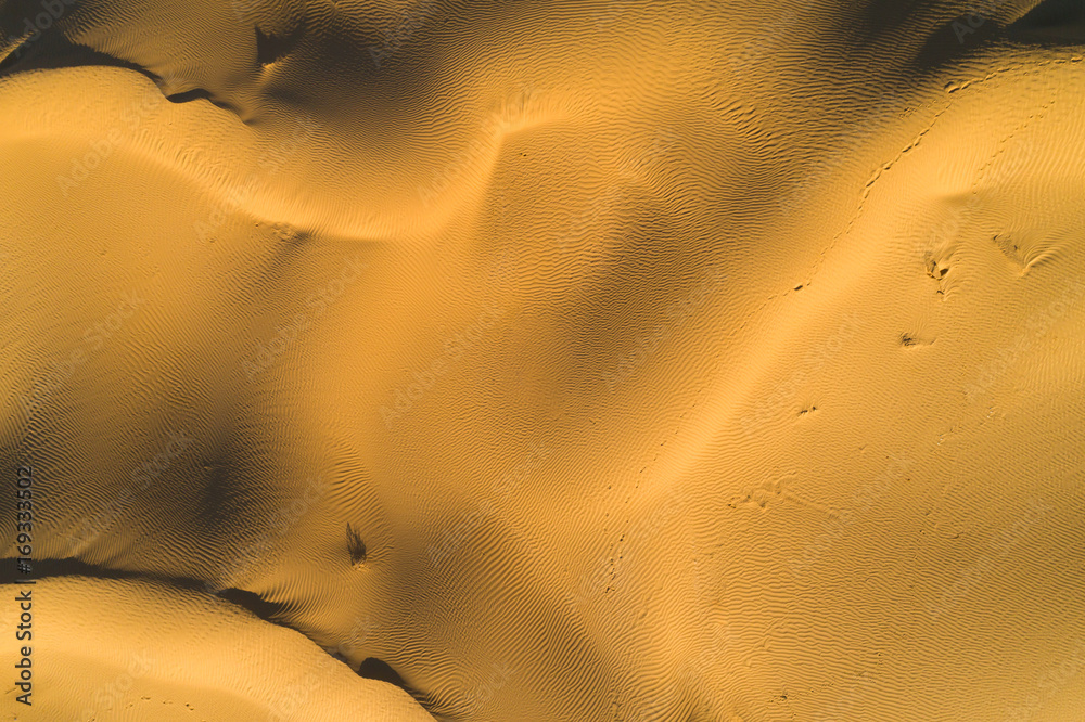 Sandy desert texture. Lines and pattern. Aerial top vertical shot.