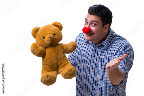 Fotografie, Obraz  Funny clown man with a soft teddy bear toy isolated on white bac