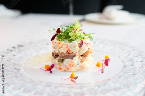 Photo sur Toile Entree Russian salad cooked in modern way, toned