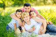 big happy family walking in the beautiful park at sunset, lie on the grass and hugs