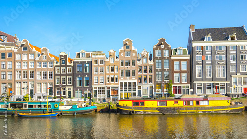 Dutch house style with the canal in Amsterdam city, Netherlands Canvas Print