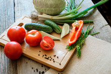 Basket With Fresh Vegetables (tomatoes, Cucumber, Chili Pepers, Dill) On Wooden Background. Outdoor, In The Garden, On The Farm. Selective Focus, Close Up. Space For Text.