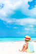 Cute little girl in hat at beach during caribbean vacation