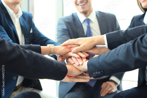 Group of businessman team touching hands together Canvas-taulu