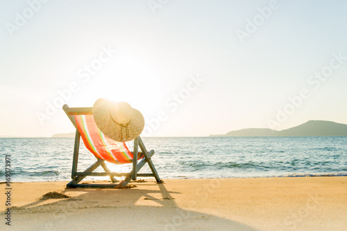 Deck chair at the beach Fotobehang
