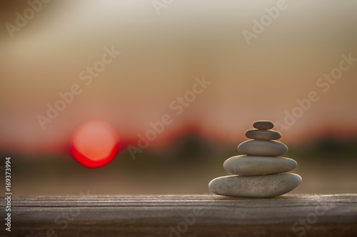 Garden Poster Zen Pyramid of stones against the sunset