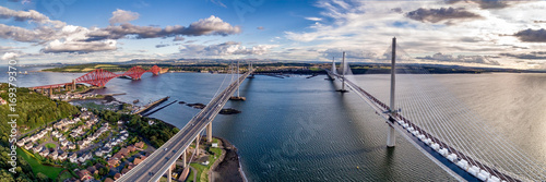 Wall Murals Northern Europe The new Queensferry Crossing bridge (on the right) over the Firth of Forth with the older Forth Road bridge (on the left) and with the iconic Forth Rail Bridge in the far left.