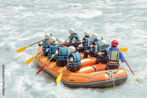 Group of people rafting on white water, active vacations, team concept