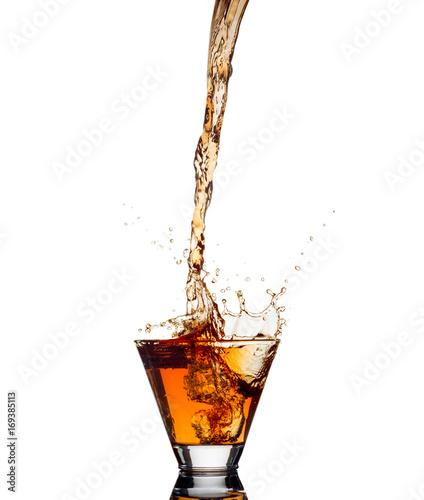 Fototapeta Whiskey splash out of glass isolated on white background obraz