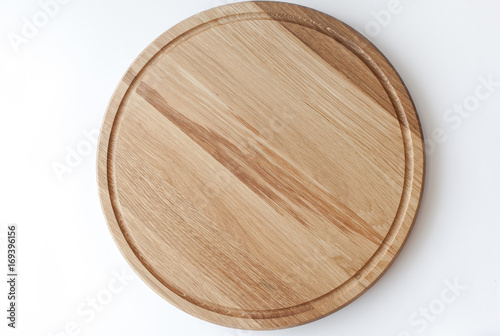 Foto  wooden cutting board on white background