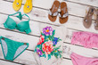 Background of stylish swimsuits and slippers.