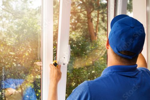 Fototapeta worker installing new plastic pvc window obraz