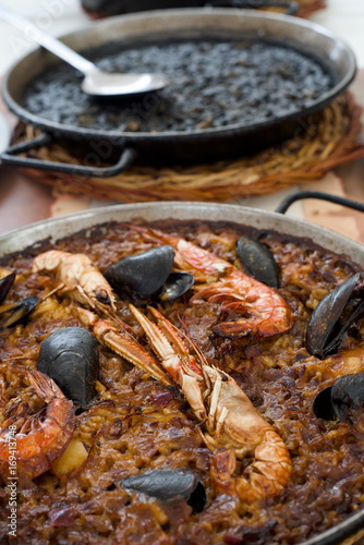 spanish seafood paella and black paella