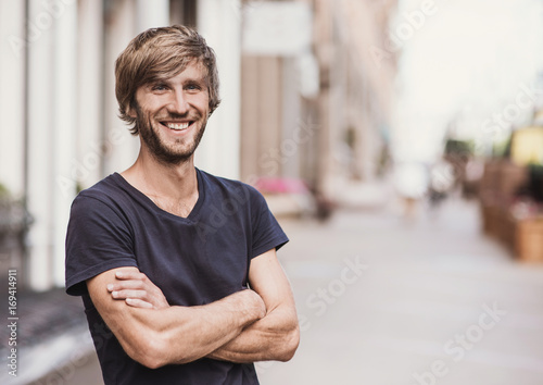 fototapeta na ścianę Handsome smiling young man portrait. Cheerful men looking at camera