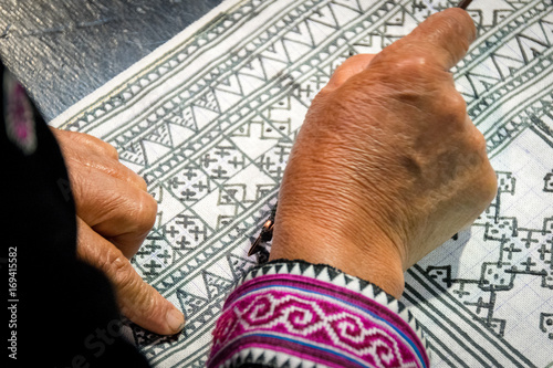 Close up Hmong hilltribe Writing candles to handmade batik in thailand Tapéta, Fotótapéta