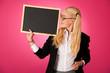 Leinwandbild Motiv funky business woman holding a blank blackboard - teacher