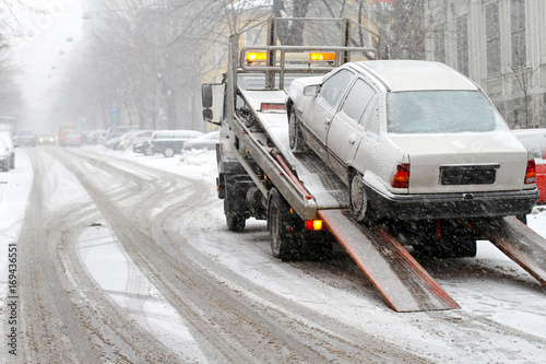 Towing car at winter snow