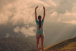 Woman is a traveler on top of a mountain. The concept of active and successful life