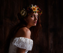 Young Woman Wearing A Flower Wreath