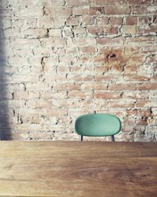 Blue Chair At Exposed Brick Wall