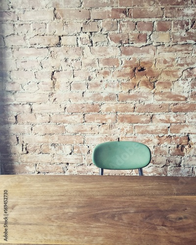 Blue chair at exposed brick wall - 169452730