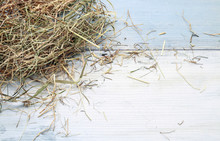 Hay On Wooden Background