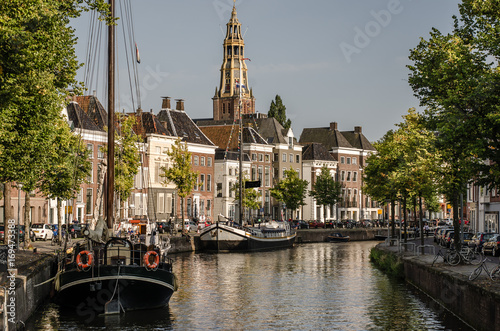 Photo Groningen, Groningen - 22 augustus 2017: View over a canel in Groningen with the