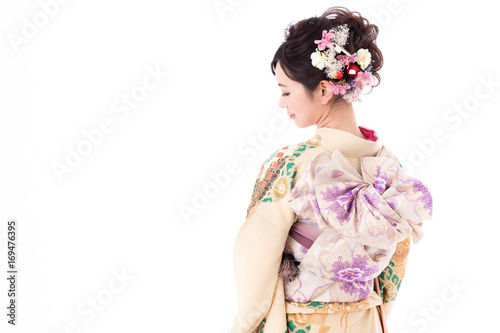 Valokuvatapetti portrait of young asian woman wearing traditional kimono isolated on white backg
