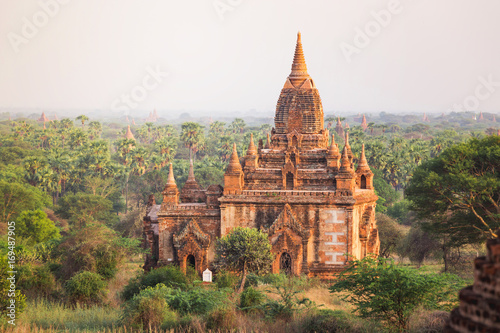 Sunrise with old temple and green lanscape, Bagan, Myanmar Poster