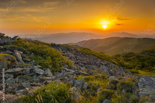 Spoed Foto op Canvas Grijze traf. Sunset in the mountains