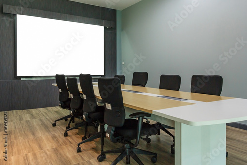 Blank projection screen in meeting room with conference table, Modern meeting ro Canvas Print