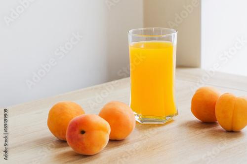 peach juice on wooden table