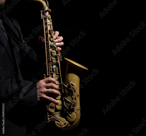 Obrazy one color   closeup-saxophone-in-player-action-on-a-dark-background