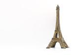 Fototapeta Fototapety z wieżą Eiffla - Metal eiffel tower souvenir Paris toy isolated on white