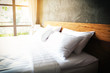 close up Bedroom Suite interior with white pillows and wall concrete background