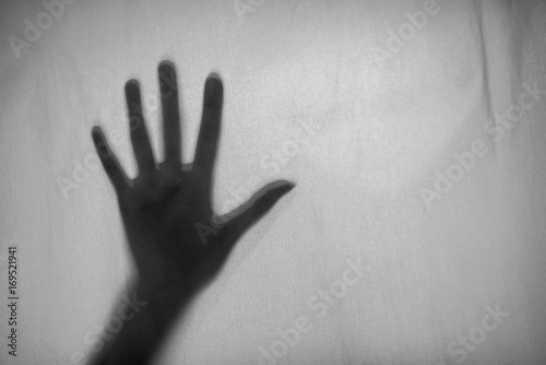 Fototapety, obrazy: Black and white photo Shadow of hand the white Blinds,fear, help, horror and scary.