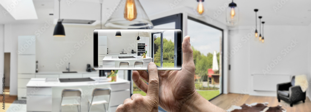 Fototapety, obrazy: Holding a mobile Smartphone and take a picture