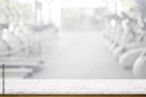 Photo sur Toile Fitness Empty white marble table space platform and fitness gym background. Product display montage Concept.
