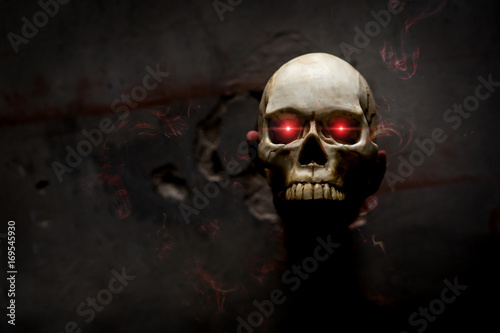 Fotografie, Obraz Hand death the ghost holding skull bone skeleton with Flame blood is screaming d