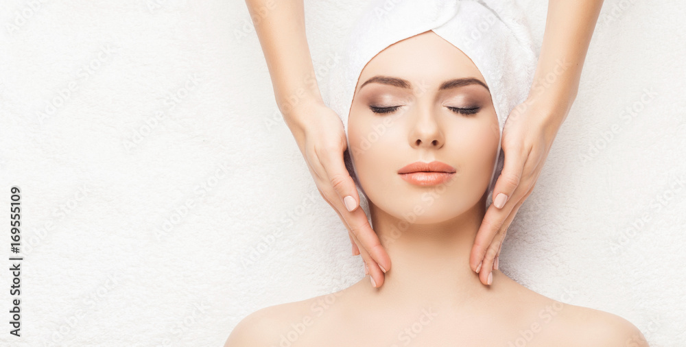 Fototapeta Portrait of a woman in spa. Massage healing procedure. Health care, skin lifting and medical concept.